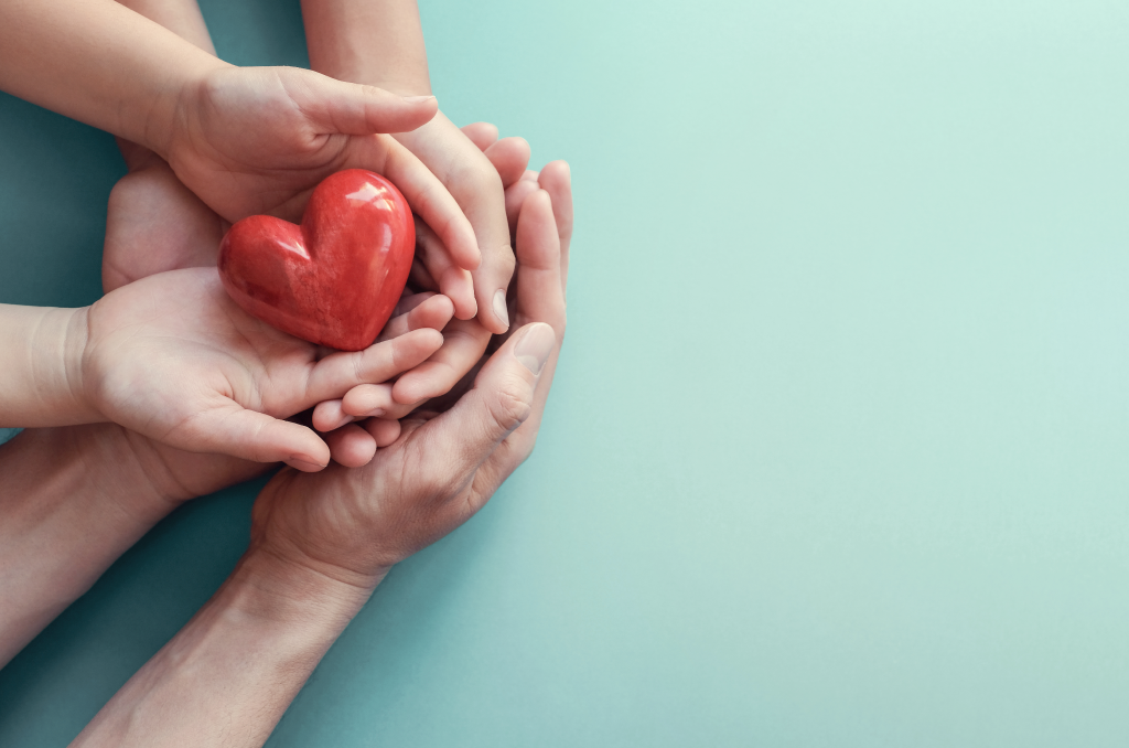 adult-child-hands-holding-red-heart-aqua-background-1024